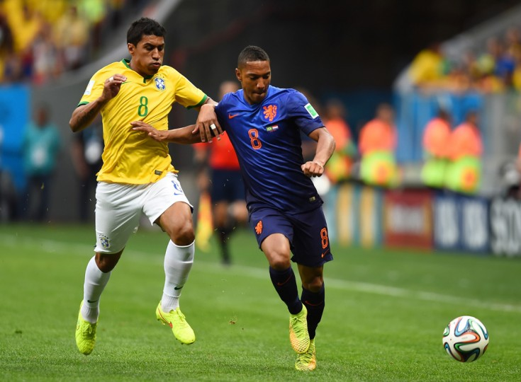 Jonathan de Guzman of the Netherlands holds off a challenge by Paulinho of Brazil during the 2014 FIFA World Cup Brazil Third Place Playoff match between Brazil and the Netherlands at Estadio Nacional on July 12, 2014 in Brasilia, Brazil. (Photo by Jamie McDonald/Getty Images)