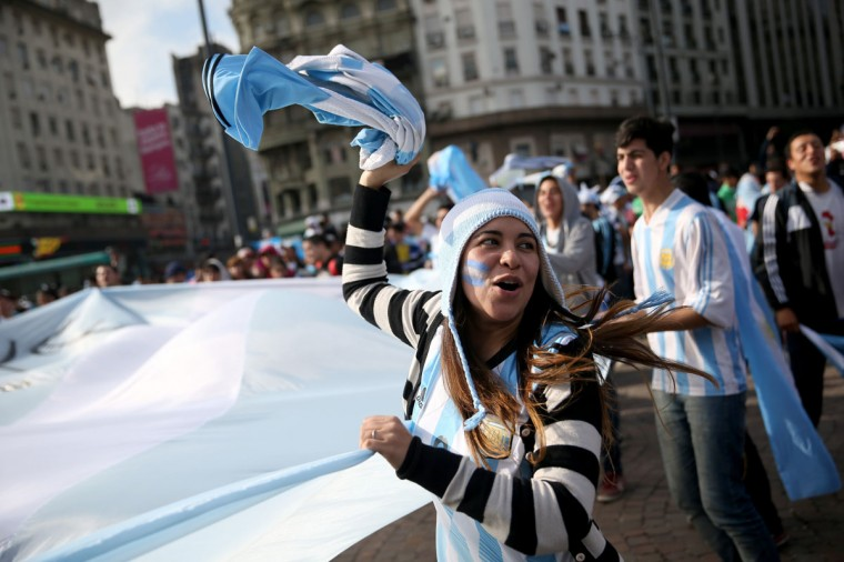 Argentine soccer fans show their spirit as the country waits for the start of the World Cup final on July 13, 2014 in Buenos Aires, Argentina. Argentina, a two time World Cup winner, will play against Germany in Rio de Janeiro, Brazil today for the World Cup trophy. (Joe Raedle/Getty Images)