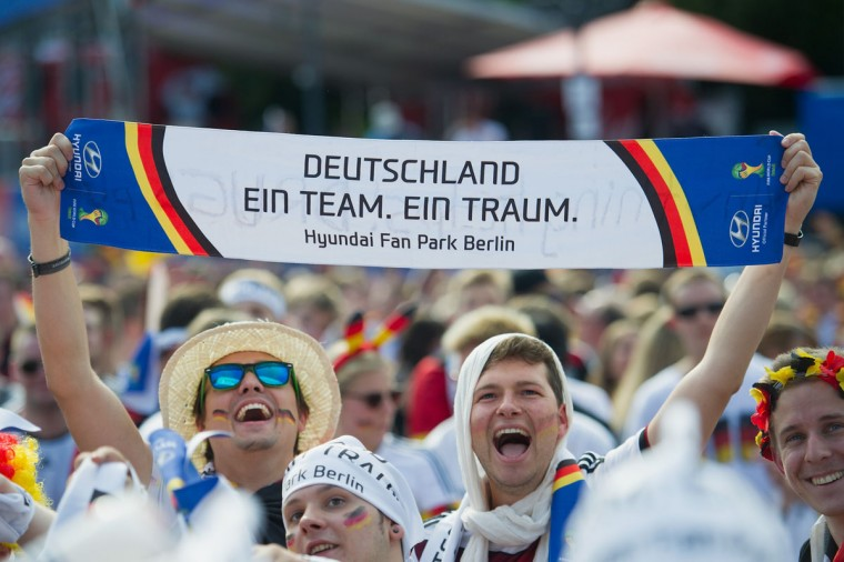 Fans of Germany celebrate prior to the 2014 FIFA World Cup Final between Germany and Argentina at the Fanmeile public viewing at Brandenburg Gate on July 13, 2014 in Berlin, Germany. (Target Presse Agentur Gmbh/Bongarts/Getty Images)