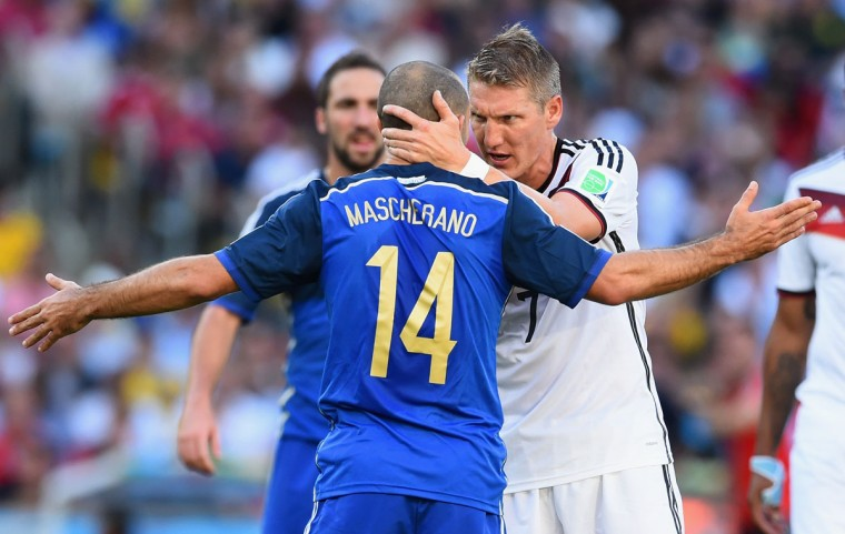 Javier Mascherano of Argentina and Bastian Schweinsteiger of Germany clash during the 2014 FIFA World Cup Brazil Final match between Germany and Argentina at Maracana on July 13, 2014 in Rio de Janeiro, Brazil. (Matthias Hangst/Getty Images)