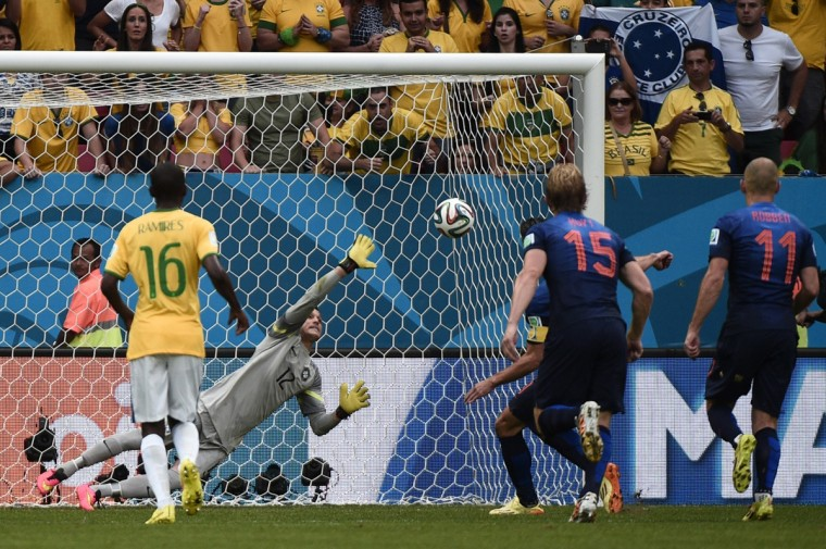 Brazil's goalkeeper Julio Cesar (R) fails to save Netherlands' forward and captain Robin van Persie's penalty during the third place play-off football match between Brazil and Netherlands during the 2014 FIFA World Cup at the National Stadium in Brasilia on July 12, 2014. (Damien Meyer/AFP/Getty Images)