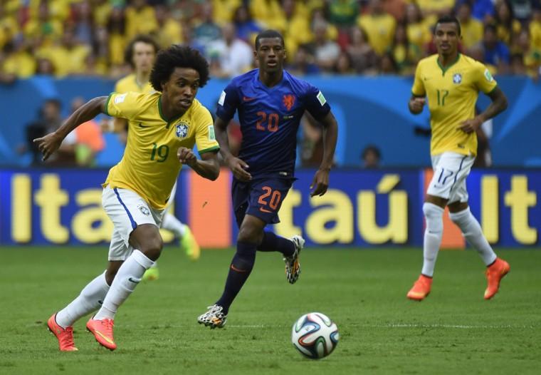 Brazil's midfielder Willian (L) and Netherlands' midfielder Georginio Wijnaldum vie during the third place play-off football match between Brazil and Netherlands during the 2014 FIFA World Cup at the National Stadium in Brasilia on July 12, 2014. (Odd Andersen/AFP/Getty Images)