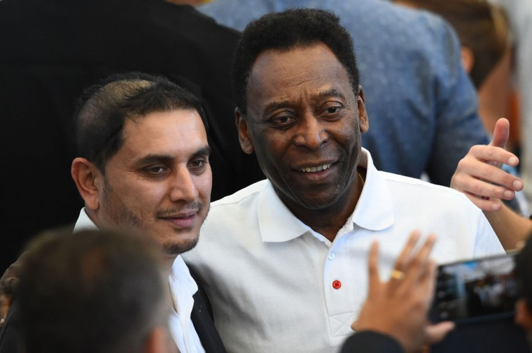 Former Brazilian footballer Pele (R) poses with fans during a closing ceremony ahead of the final football match between Germany and Argentina for the FIFA World Cup at The Maracana Stadium in Rio de Janeiro on July 13, 2014. (Christophe Simon/AFP/Getty Images)