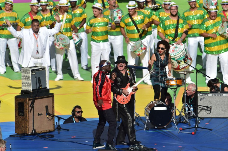 Mexican musician Carlos Santana (C) and Haitian-US musician Wyclef Jean (L) perform during the closing ceremony prior to the 2014 FIFA World Cup final football match between Germany and Argentina at the Maracana Stadium in Rio de Janeiro, Brazil on July 13, 2014. (Nelson Almeida/AFP/Getty Images)
