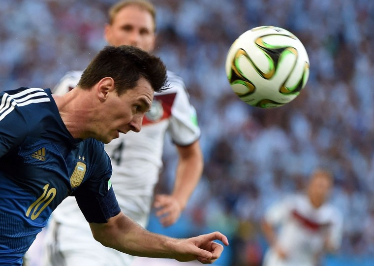 Argentina's forward Lionel Messi heads the ball during the final football match between Germany and Argentina for the FIFA World Cup at The Maracana Stadium in Rio de Janeiro on July 13, 2014. (Patrik Stollar/AFP/Getty Images)