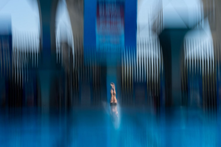 David Dinsmore of the US competes during the men's 10 meter semi-final platform event at the 19th FINA Diving World Cup in Shanghai on July 20, 2014. (Johannes Eisele/AFP/Getty Images)