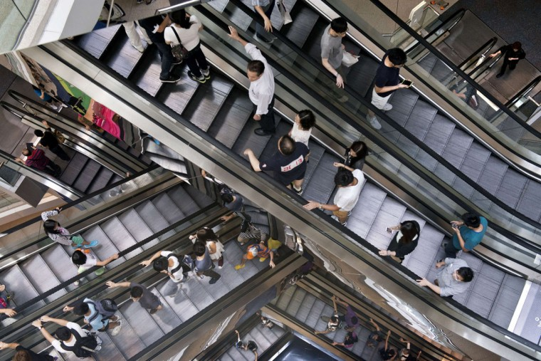 People ride on escalators in a shopping mall in Hong Kong on July 20, 2014. Hong Kong's economy in 2014 is expected to expand at its fastest pace in three years, according to government estimations, with a forecasted growth of between three and four percent, up from 2.9 percent in 2013. (Alex Ogle/AFP/Getty Images)