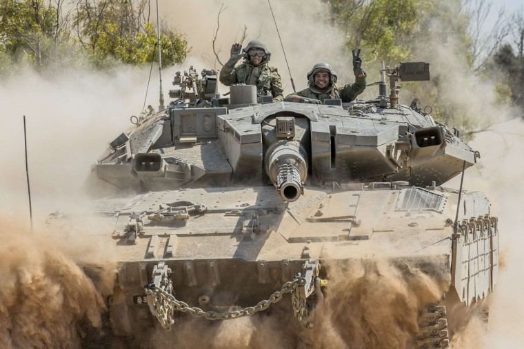 Israeli soldiers flash the sign of victory on a Merkava tank at an army deployment near Israel's border with the Gaza Strip on July 20, 2014. Israel says its offensive against the Gaza Strip that began on July 8, and which has killed more than 425 Palestinians, is aimed at destroying tunnels used by militants from Hamas and other groups to infiltrate Israeli lines, and stop rocket attacks. (Jack Guez/AFP/Getty Images)