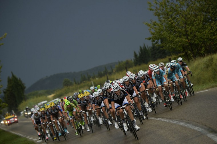 The pack rides during the 222 km fifteenth stage of the 101st edition of the Tour de France cycling race on July 20, 2014 between Tallard and Nimes, southern France. (AFP PHOTO/Getty Images/Lionel Bonaventure)