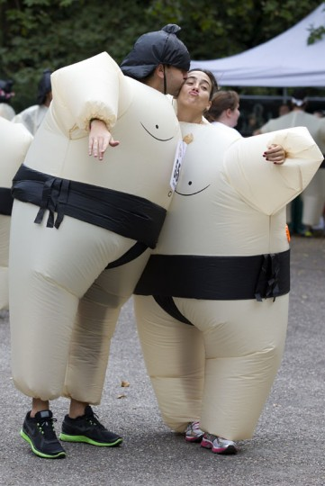 Participants kiss wearing inflated suits before taking part in The Sumo Run in Battersea Park, London, on July 27, 2014. The Sumo Run is an annual 5km charity fun run around the park in inflatable sumo suits. (Justin Tallis/AFP/Getty Images)