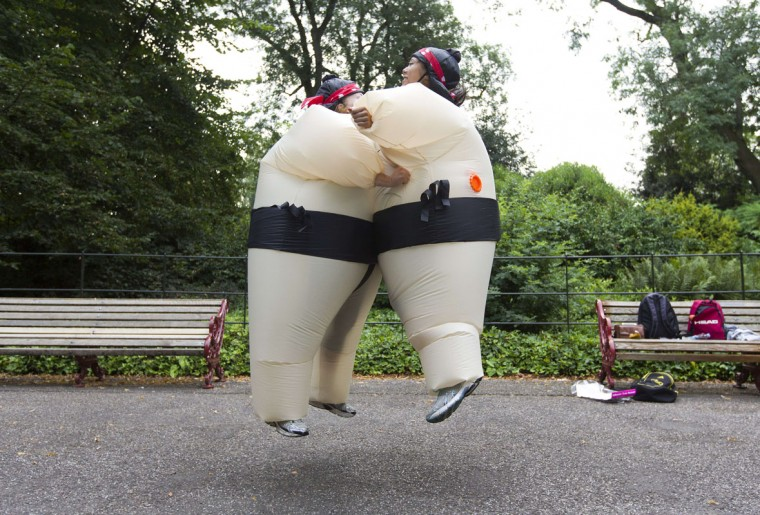 Participants in inflated suits jump into a chest bump before taking part in The Sumo Run in Battersea Park, London, on July 27, 2014. The Sumo Run is an annual 5km charity fun run around the park in inflatable sumo suits. (Justin Tallis/AFP/Getty Images)