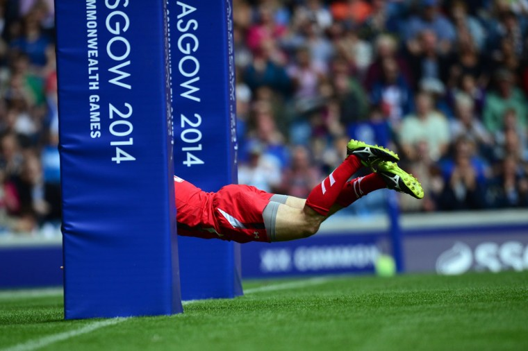 Lee Williams of Wales scores a try against Australia during the Rugby Sevens quarter-final match between Australia and Wales at Ibrox Stadium during the 2014 Commonwealth Games in Glasgow on July 27, 2014. (Carl Court/AFP/Getty Images)