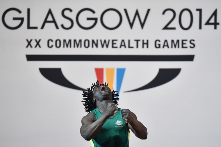 Australia's Bronze medalist Francois Etoundi competes in the men's weightlifting 77kg class at the SECC Precinct during the 2014 Commonwealth Games in Glasgow, Scotland. ( Ben Stansall/AFP/Getty Images)