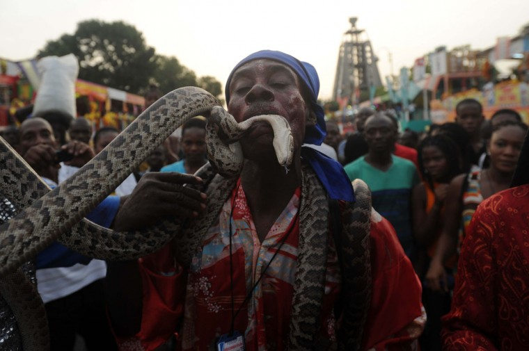 Haitians participate in the first day of the Carnival of Flowers July 27, 2014, in Port au Prince, Haiti. The three-day festival celebrate through the streets of Hatian capital's downtown. (Hector Retamal/AFP/Getty Images)