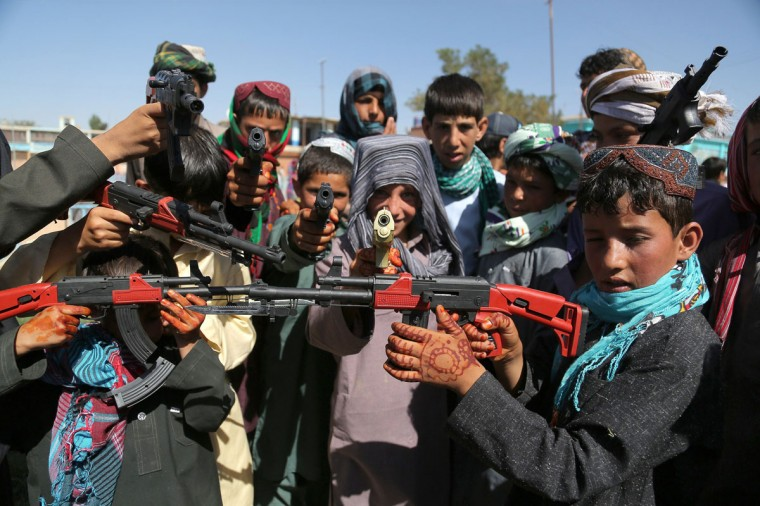 Afghan children play with plastic guns as they celebrate Eid al-Fitr and the end of the fasting month of Ramadan in Ghazni on July 28, 2014. Muslims around the world are celebrating Eid al-Fitr this week, marking the end of the holy month of Ramadan during which followers are required to abstain from food, drink and sex from dawn to dusk. (Rahmatullah Alizadah/AFP/Getty)