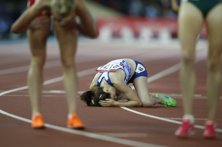 Scotland's Laura Muir lies on the track at the end of the final of the women's 1500m athletics event at Hampden Park during the 2014 Commonwealth Games in Glasgow, Scotland on July 29, 2014. (Adrian Dennis/Getty Images)