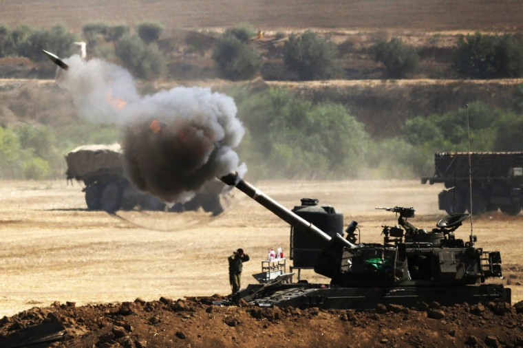 An Israeli artillery gun fires a 155mm shell towards targets from their position near Israel's border with the Gaza Strip on July 30, 2014. Israel agreed to observe a four-hour lull in Gaza several hours after a deadly strike on a school killed 16, drawing a furious response from a UN refugee agency. (Jack Guez/Getty Images)