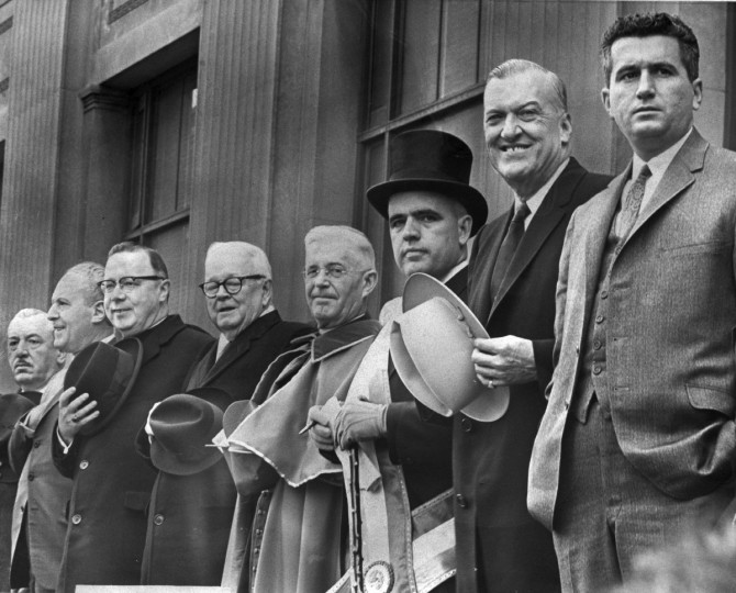March 1966 - The St. Patrick's Day Parade viewing stand on Cathedral Street, from left: Thomas J. D'Alesandro 2d, former mayor; State Comptroller Louis L. Goldstein, Bishop T. Austin Murphy, Gov. Tawes, Cardinal Shehan, John J. Sweeney, parade Chairman; Mayor McKeldin and Thomas J. D'Alesandro 3d, Council President. Mayor holds LBJ hat. (William L. LaForce, Jr./Baltimore Sun)