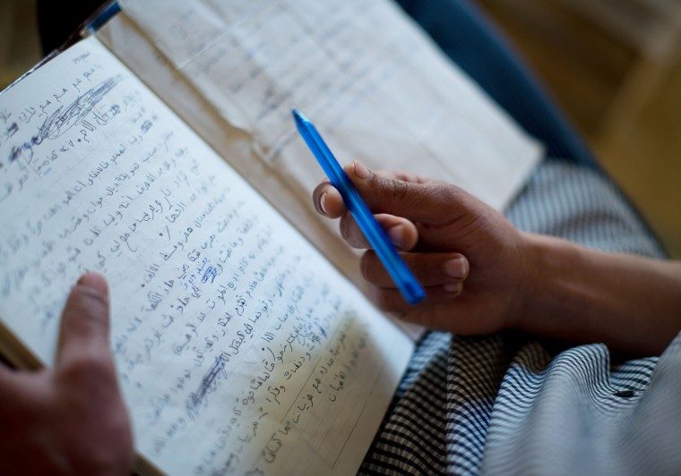 Mohamed El-Kotbi, 17, of the Province of Ouezzane, Morocco, holds his pen over his notebook of raps. El-Kotbi recently started writing his own raps and wrote a rap about children with Xeroderma Pigmentosum. Rachel Woolf/Baltimore Sun