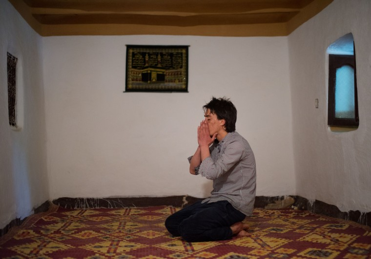 Mohamed El-Kotbi, 17, of the Province of Ouezzane, Morocco, prays during the morning prayer. Rachel Woolf/Baltimore Sun