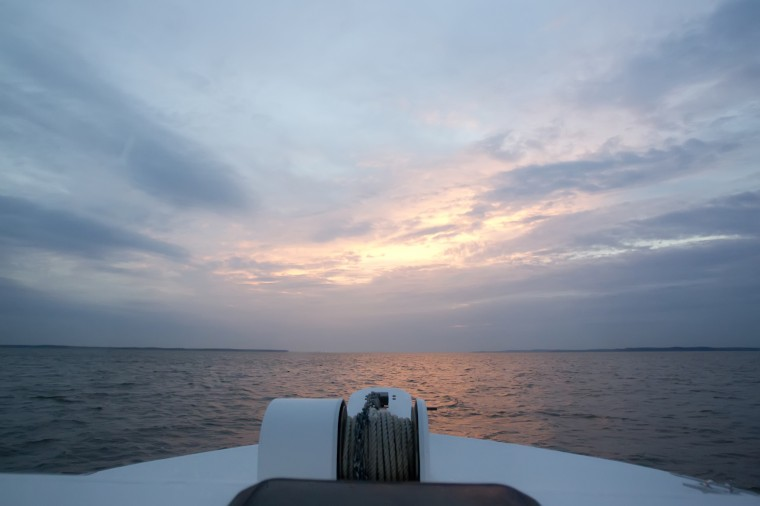 The view from Tony Conrad's boat while crabbing off of Galloway Creek Marina as the sun sets in Bowley's Quarters, July 16, 2014. (Jen Rynda/BSMG)