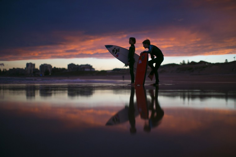 Young surfers, nicknamed 'grommets' in local surfing parlance, wait for their friends to finish a post-sunset session on the waves off Wanda Beach in Sydney. Many of Sydney's famed beaches remain popular with surfers during the southern hemisphere winter months despite early sunsets and cooler ocean temperatures. (Jason Reed/Reuters)