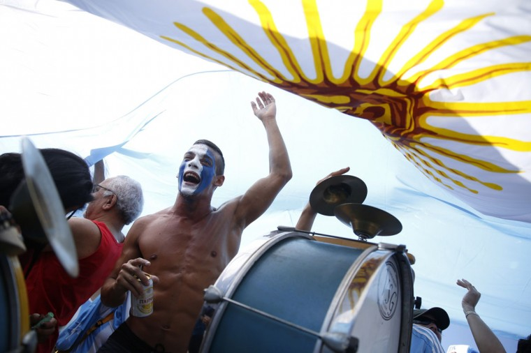 Argentine fans chant slogans as they arrive at Copacabana beach ahead of the 2014 World Cup final match against Germany in Rio de Janeiro July 13, 2014. (Pilar Olivares/Reuters)