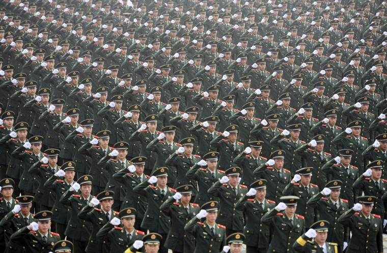 Paramilitary policemen raise their fists as they attend an oath-taking rally to ensure the security of the upcoming 2014 Nanjing Youth Olympic Games, in Nanjing, Jiangsu province July 29, 2014. The eastern Chinese city of Nanjing will host the 2014 Youth Olympic Games between August 16 to August 28. (REUTERS/China Daily)