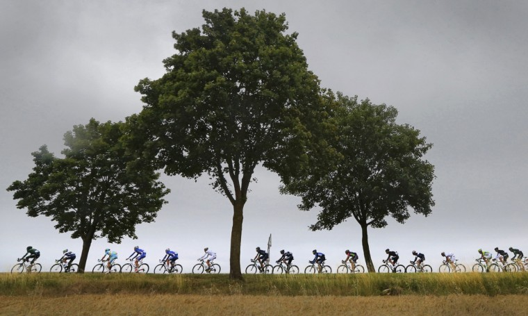 The pack of riders cycle through rural France during the 7th stage of the Tour de France cycle race between Epernay and Nancy, July 11, 2014. (Jean-Paul Pelissier/Reuters)