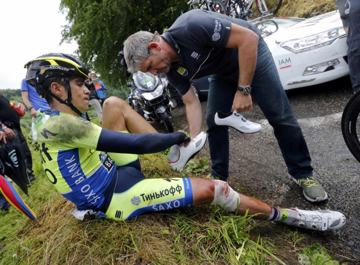 Tinkoff-Saxo team rider Alberto Contador of Spain gets medical assistance after he fell during the 161.5-km tenth stage of the Tour de France cycling race between Mulhouse and La Planche Des Belles Filles July 14, 2014. (Jean-Paul Pelissier/Reuters)