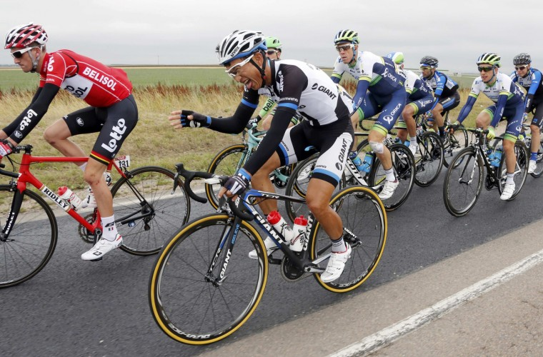 Giant-Shimano team rider Cheng Ji of China reacts as he cycles among the pack during the 234.5 km seventh stage of the Tour de France cycling race from Epernay to Nancy July 11, 2014. (Jean-Paul Pelissier/Reuters)