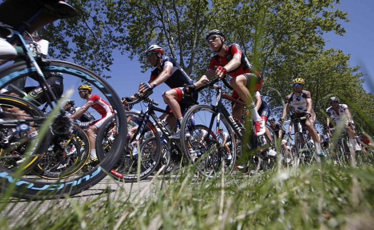 The pack of riders cycles on its way during the 185.5-km 12th stage of the Tour de France cycling race between Bourg-en-Bresse and Saint-Etienne July 17, 2014. (Christian Hartmann/Reuters)