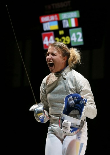 Olga Kharlan of Ukraine celebrates the victory after competing against Rossella Gregorio of Italy in their women's team sabre third place match at the World Fencing Championships in Kazan July 21, 2014. (REUTERS/Grigory Dukor)