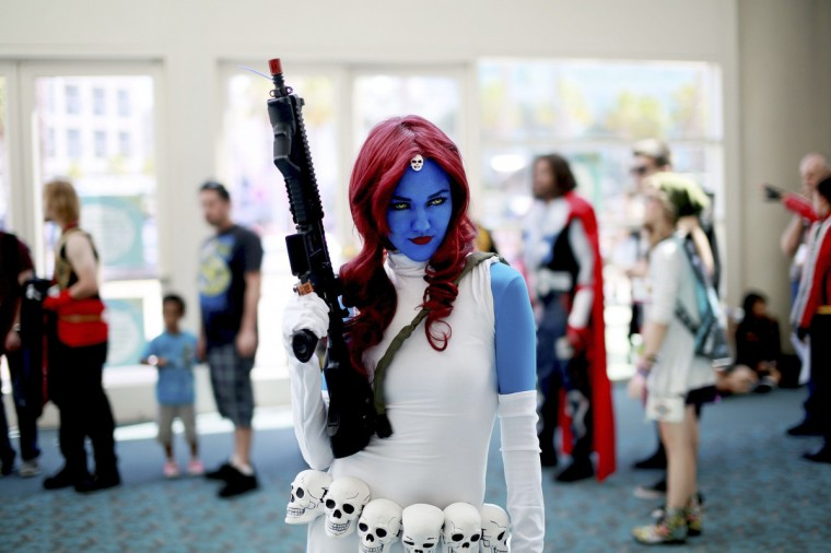 Allie Shaughnessy, who is dressed as Mystique, poses during the 2014 Comic-Con International Convention in San Diego, California July 24, 2014. (Sandy Huffaker/Reuters)