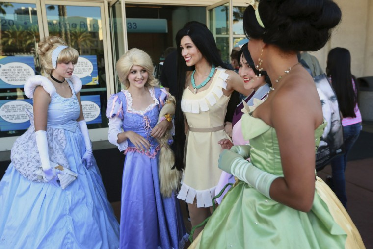 Costumed attendees stand outside the Convention Center during the 2014 Comic-Con International Convention in San Diego, California, July 23, 2014. (Sandy Huffaker/Reuters)