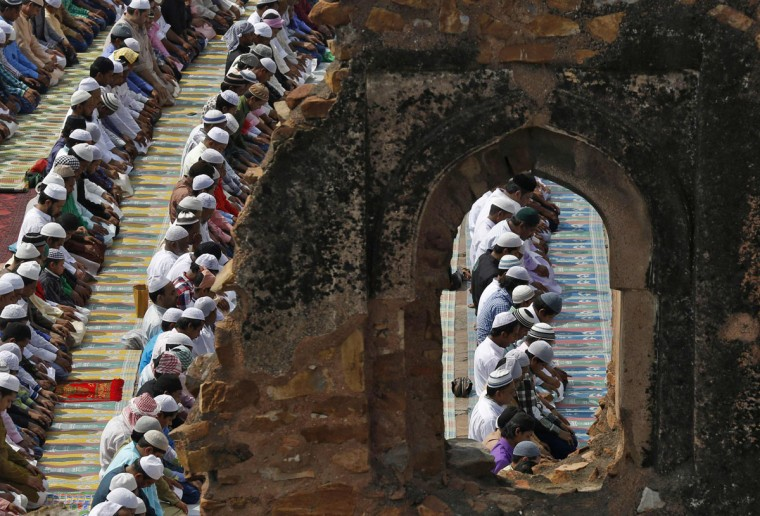 Muslims offer prayers at the ruins of the Feroz Shah Kotla mosque on the occasion of Eid al-Fitr in New Delhi July 29, 2014. The Eid al-Fitr festival marks the end of the holy month of Ramadan. (REUTERS/Ahmad Masood)