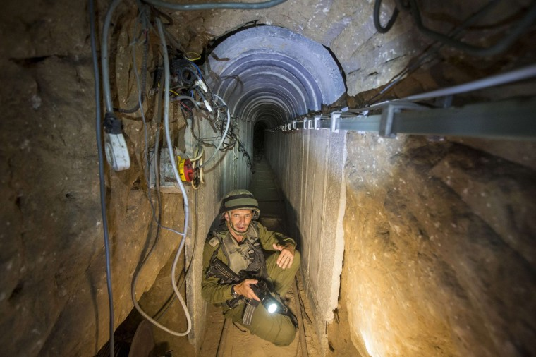 An Israeli army officer gives explanations to journalists during an army organised tour in a tunnel said to be used by Palestinian militants for cross-border attacks, July 25, 2014. U.S. Secretary of State John Kerry pressed regional leaders to nail down a Gaza ceasefire on Friday as the civilian death toll soared, and further violence flared between Israelis and Palestinians in the occupied West Bank and Jerusalem. (Jack Guez/Pool/Reuters)
