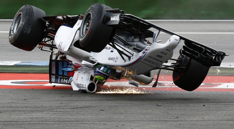 Williams Formula One driver Felipe Massa of Brazil crashes with his car in the first corner after the start of the German F1 Grand Prix at the Hockenheim racing circuit, July 20, 2014. (Kai Pfaffenbach/Reuters)