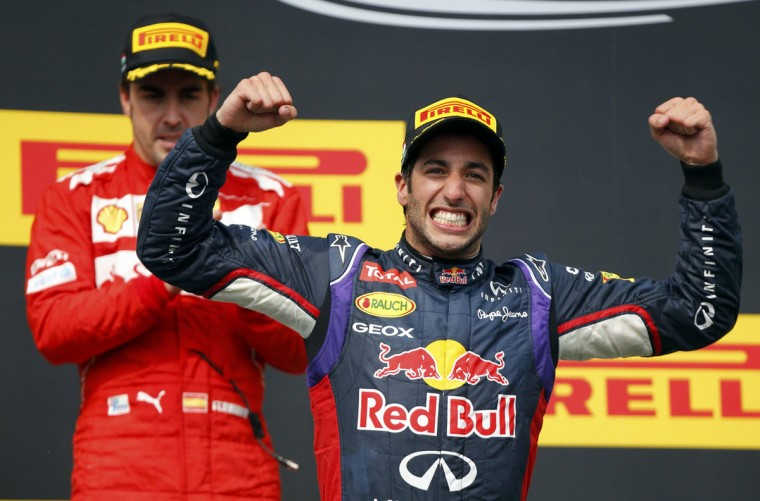 Winner Red Bull Formula One driver Daniel Ricciardo of Australia celebrates in front of second placed Ferrari Formula One driver Fernando Alonso of Spain (L) after the Hungarian F1 Grand Prix at the Hungaroring circuit, near Budapest July 27, 2014. (Laszlo Balogh/Reuters)