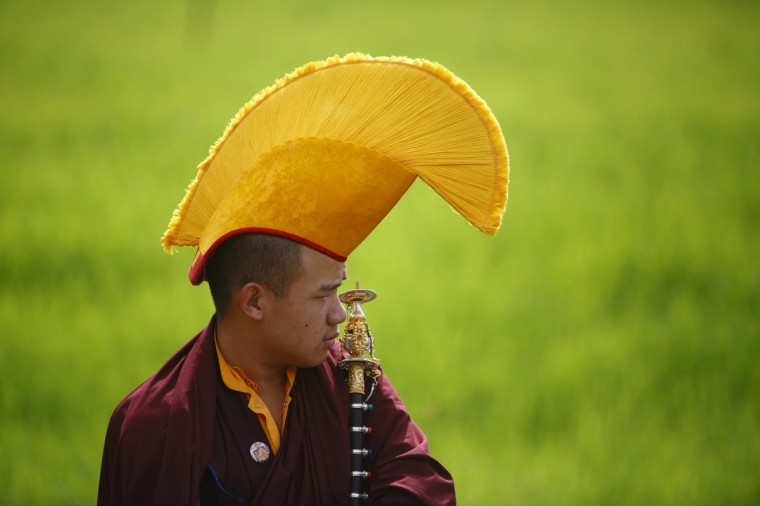 A Buddhist monk takes part in the funeral of Shamar Rinpoche in a monastery in Kathmandu July 31, 2014. Nepal has allowed a monk prominent in Tibetan Buddhism to be cremated in a monastery in Kathmandu, a minister said on Tuesday, disregarding fears of possible anti-China protests by his followers during the funeral. The government had previously barred the followers of Shamar Rinpoche from bringing his body back to Nepal - where he ran a monastery - for the final rites, a decision that local media had blamed on pressure from China. Rinpoche, also known as the Shamarpa, died of a heart attack in Germany aged 62 on June 11. REUTERS/Navesh Chitrakar