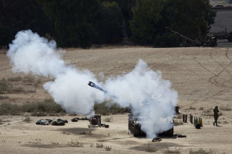 An Israeli mobile artillery unit fires towards Gaza from outside the central Gaza Strip. Israeli shelling killed four boys on a Gaza beach on Wednesday, a local health official said, and Palestinian militants fired a further 70 rockets into Israel after a failed Egyptian attempt to halt more than a week of warfare. (Baz Ratner/Reuters)