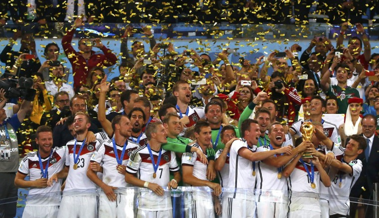 Germany players celebrate with their trophy after winning the 2014 World Cup final between Germany and Argentina at the Maracana stadium in Rio de Janeiro July 13, 2014. (Michael Dalder/Reuters)