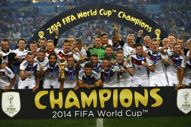 Germany players celebrate with their trophy after winning the 2014 World Cup final between Germany and Argentina at the Maracana stadium in Rio de Janeiro July 13, 2014. (Darren Staples/Reuters)