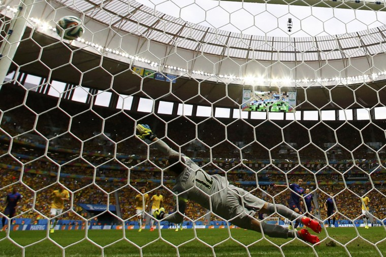 Robin van Persie of the Netherlands (4th R) scores a goal from a penalty kick past Brazil's goalkeeper Julio Cesar (12) during their 2014 World Cup third-place playoff at the Brasilia national stadium in Brasilia July 12, 2014. (Dominic Ebenbichler/Reuters)