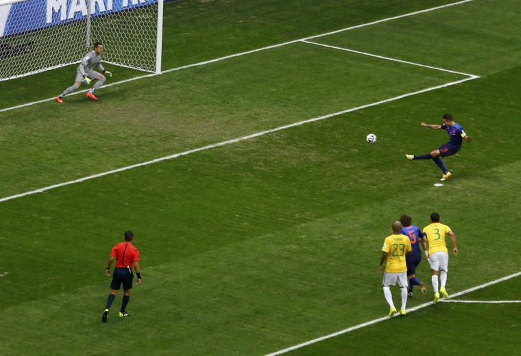 Robin van Persie of the Netherlands shoots to score a goal against Brazil during their 2014 World Cup third-place playoff at the Brasilia national stadium in Brasilia July 12, 2014. (Ruben Sprich/Reuters)