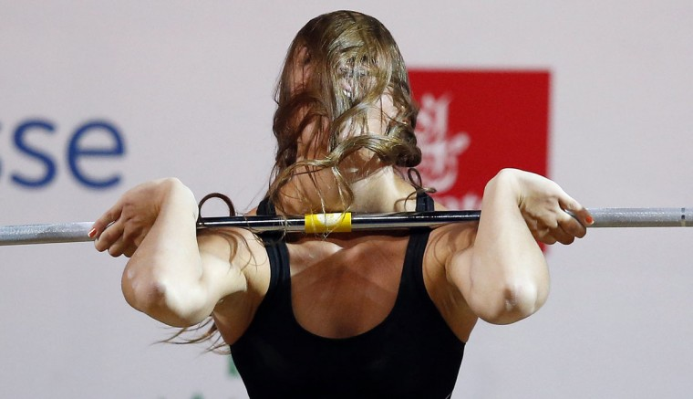 Marie-Julie Malboeuf of Canada lifts during the women's 58kg weightlifting competition at the 2014 Commonwealth Games in Glasgow, Scotland, July 26, 2014. (Phil Noble/Reuters)