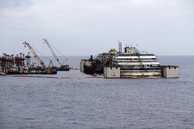 Cruise liner Costa Concordia is seen after a refloat operation at Giglio harbor at Giglio Island July 14, 2014. (REUTERS/Alessandro Bianchi)