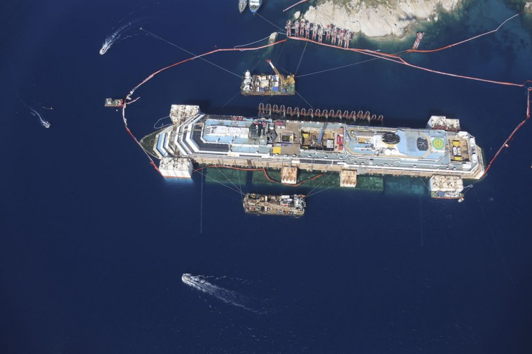 An aerial view of the Costa Concordia cruise liner is photographed from an Italian Civil Protection plane during the refloat operation at Giglio harbor at Giglio Island, in this July 19, 2014 Italian Civil Protection handout photograph. (Protection/Handout via Reuters)