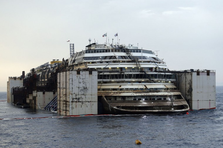 The Costa Concordia cruise liner is pictured from a ferry as it emerges during the refloating operation at Giglio harbor July 20, 2014. (REUTERS/Giampiero Sposito)