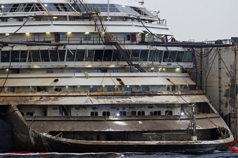 The bow of the Costa Concordia cruise liner is pictured from a ferry as it emerges during the refloating operation at Giglio harbor July 20, 2014. (REUTERS/Giampiero Sposito)